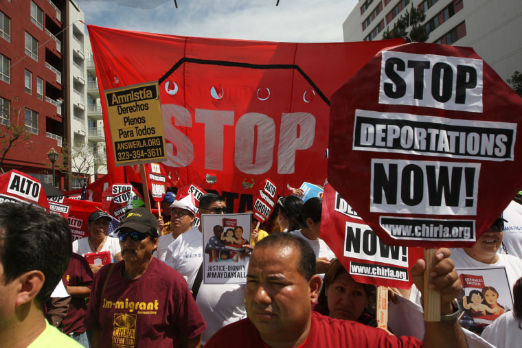 Marchers rally under the Chinatown Gateway during one a several May Day immigration-themed events on May 1, 2014 in Los Angeles, California.