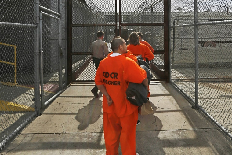 New arrivals to the Deuel Vocational Institution are taken inside the prison near Tracy, Calif., Feb. 20, 2014.