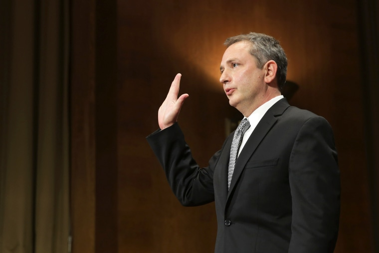 David Barron is sworn in before testifying to the Senate Judicary Committee during his nomination hearing in Washington, DC. Nov. 20, 2013.