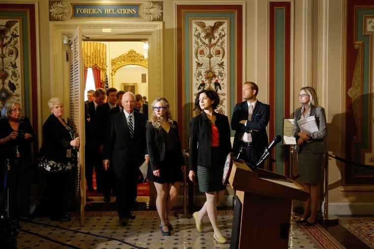 Nadya Tolokonnikova (R) and Maria Alyokhina (C), members of the Russian punk protest group Pussy Riot, leave the Senate Foreign Relations Committee room at the U.S. Capitol on May 6, 2014