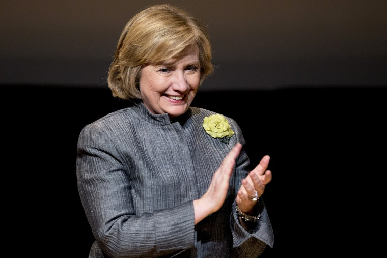 Former Secretary of State Hillary Rodham Clinton smiles following her speech at the Inter-American Development Bank in Washington, May 6, 2014.