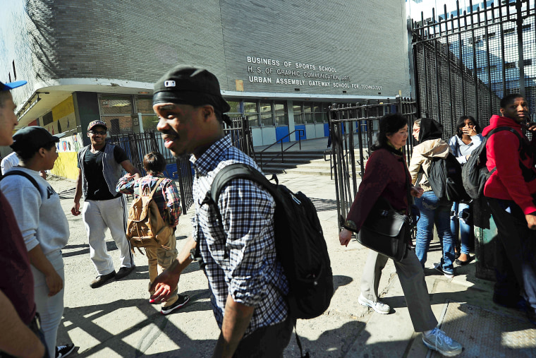 High school students leave the High School of Graphic Communication Arts in New York on April, 30, 2013