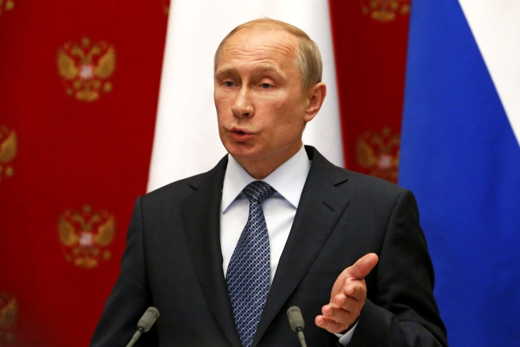 Russian President Vladimir Putin speaks at a joint news conference in Moscow, May 7, 2014.