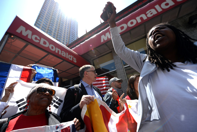 Fast-food workers from around the world stage a protest in front of a McDonald's restaurant, campaigning for higher pay, in New York on May 7, 2014