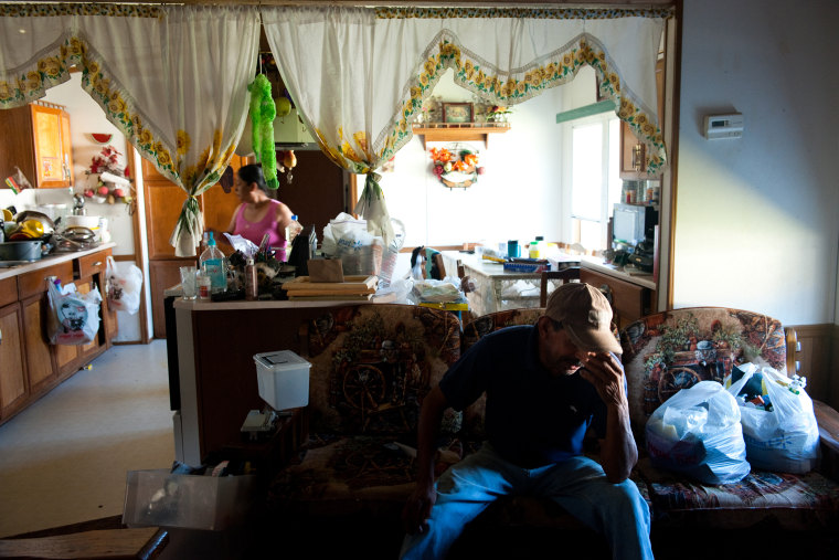 Praxedis Teran, left and Angel Coronilla, in their mobile home in Foley, Ala. on Oct. 7, 2011, shortly after Alabama passed one of the strictest immigration laws in the country.