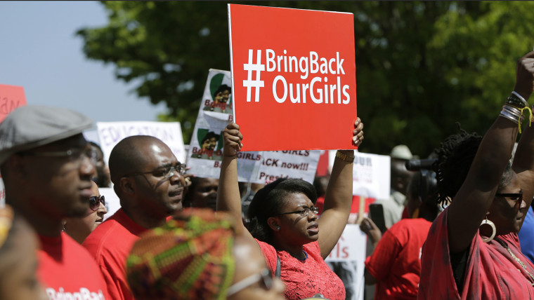 Protesters march in support of the girls kidnapped by members of Boko Haram in front of the Nigerian Embassy in Washington