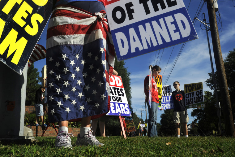 Members of the Westboro Baptist Church picket a city park near their church in Topeka, Kan.