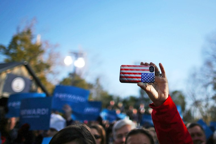 A cell phone with an American flag cover is held up during a rally  in Sterling, Virginia.