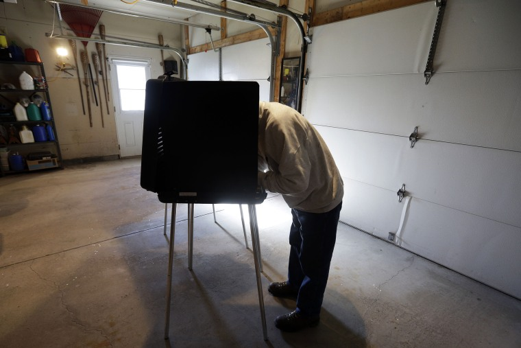 A man casts his vote at a polling place inside a residential garage, Nov. 6, 2012, in Forest City, Pa.
