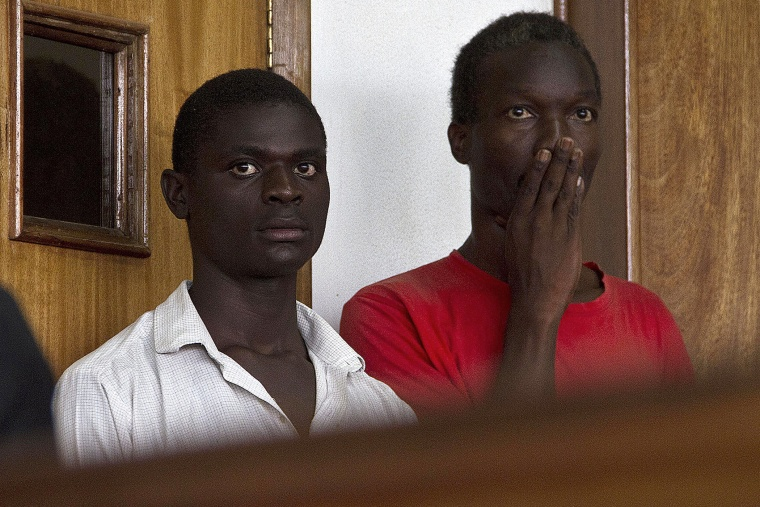 Two Ugandan men, Kim Mukisa (R) and Jackson Mukasa (L) appear before the Uganda Chief Magistrates Court in Kampala on May 7, 2014.