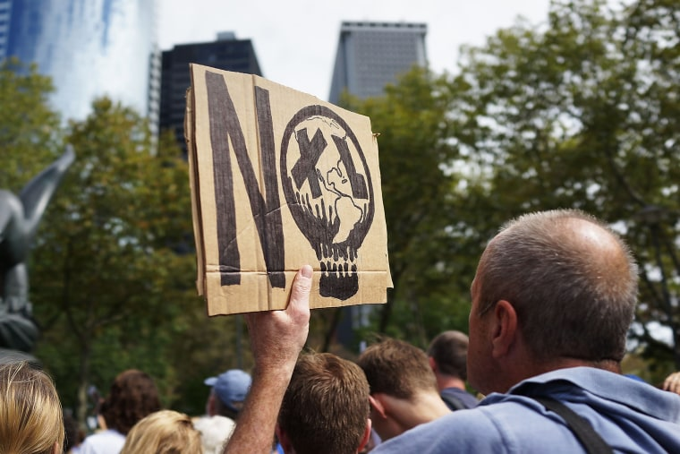 Anti-fracking and Keystone XL pipeline activists demonstrate in lower Manhattan on September 21, 2013 in New York City