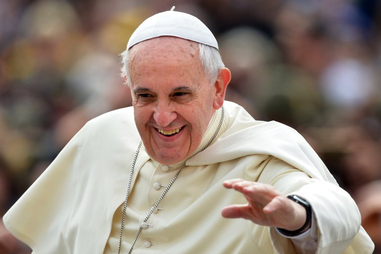 Pope Francis waves to the crowd as he arrives to hold his general audience at St Peter's square, on May 7, 2014 in Vatican city.