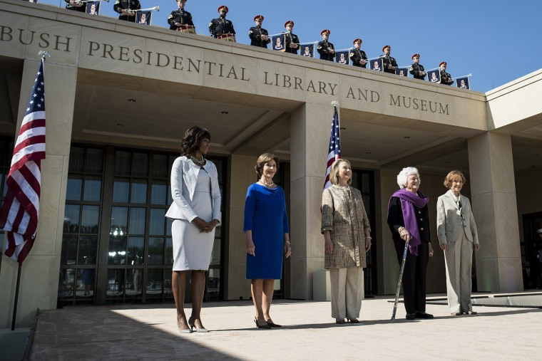 From left US first lady Michelle Obama, stands with former first ladies Laura Bush, Hillary Clinton, Barbara Bush and Rosalynn Carter as they arrive for a dedication ceremony at the George W. Bush Library and Museum, April 25, 2013 in Dallas, Texas.