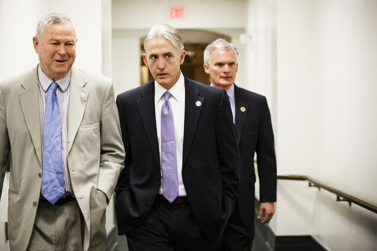 Rep. Trey Gowdy, R-S.C., center, walks to a House Republican Conference meeting at the Capitol, May 7, 2014.