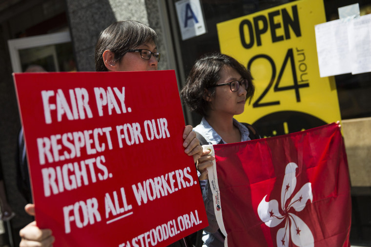 Protesters lobby for higher wages for fast food workers and urge fast food workers from around the globe to join their campaign outside a McDonalds on May 7, 2014 in New York City.