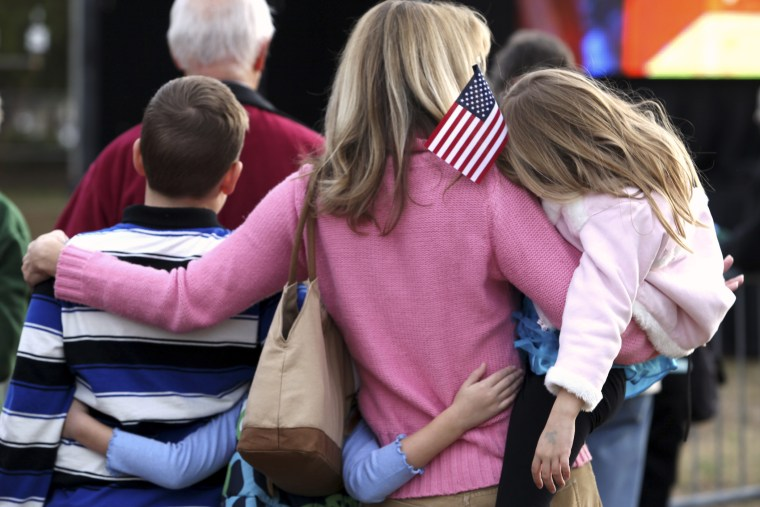A mother huddles with her children while at an event in Myrtle Beach, South Carolina, Jan. 16, 2012.