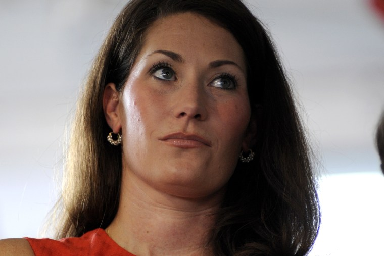 Kentucky Secretary of State Alison Lundergan Grimes, candidate for U.S. Senate, waits to speak during the 133rd Annual Fancy Farm Picnic in Fancy Farm, Ky., Aug. 3, 2013.