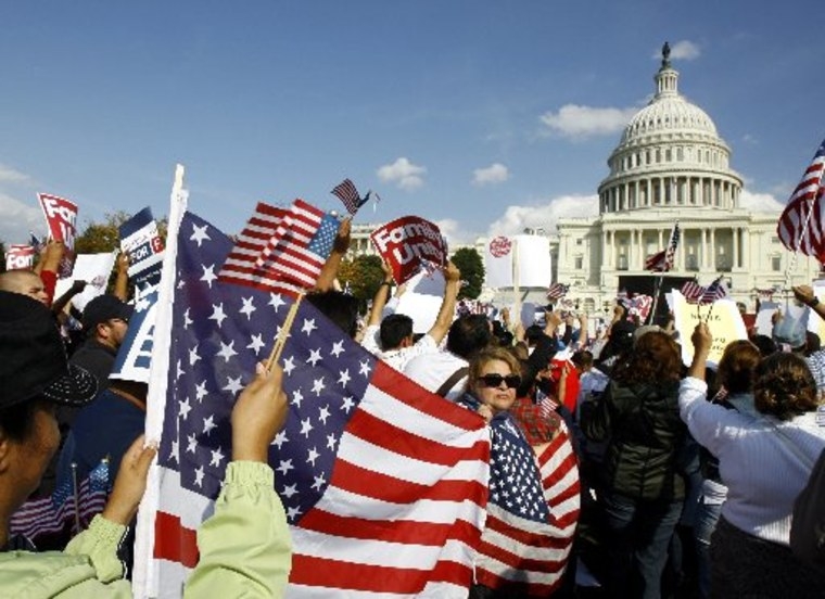 Demonstrators protest during an immigration reform rally in front of the U.S. Capitol on Capitol Hill in Washington in this October 13, 2009 file photo.