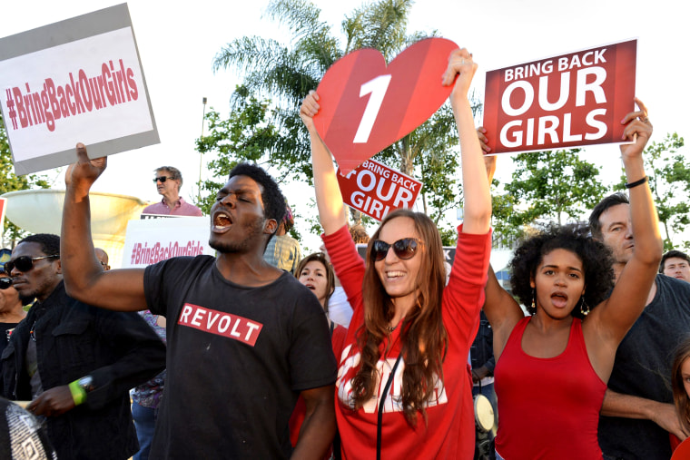 "People participate in a ""Bring Back Our Girls"" campaign demonstration and candlelight vigil, held on Mother's Day in Los Angeles May 11, 2014."