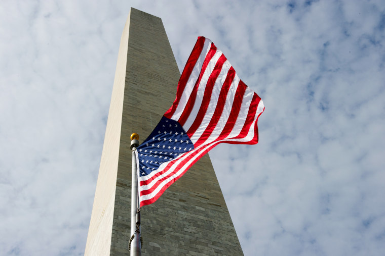 The Washington Monument is seen behind the US flag May 12, 2014 in Washington, DC.