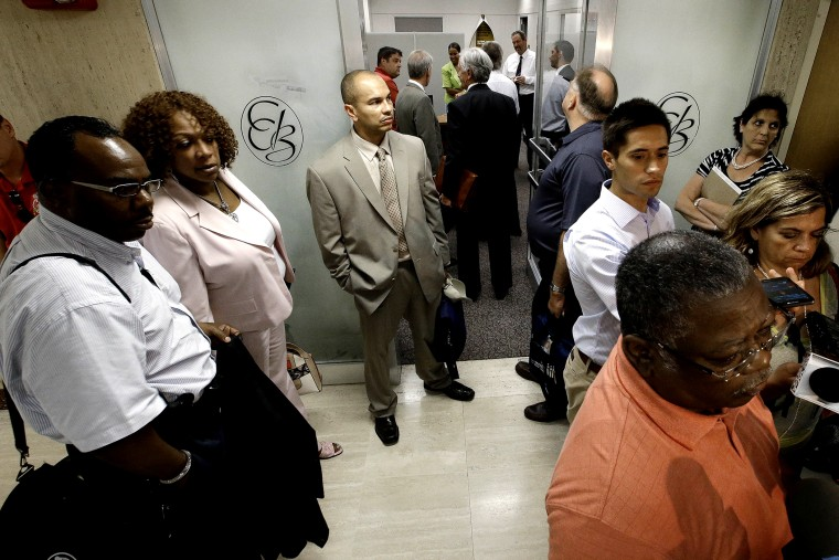 Representatives of Detroit's active and retired public workers wait for a meeting to start in Detroit, on July 10, 2013.