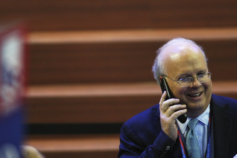 Karl Rove speaks on a cellphone during the Republican National Convention at the Tampa Bay Times Forum.
