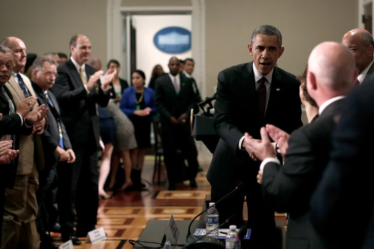 U.S. President Barack Obama greets law enforcement leaders from across the country after speaking to them in the Eisenhower Executive Office Building on May 13, 2014 in Washington, DC.