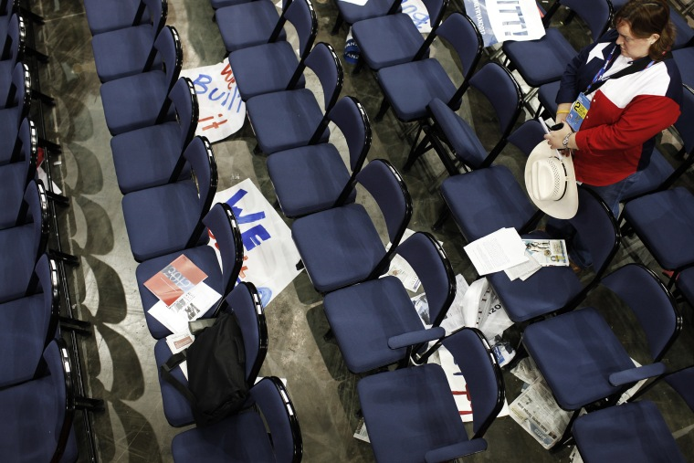 A delegate from Texas prays during the Republican National Convention.
