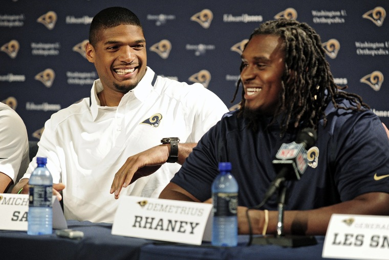 Michael Sam (left) jokes around with seventh round pick offensive lineman Demetrius Rhaney during a press conference at Rams Park on May 13, 2014 in St. Louis, Mo.