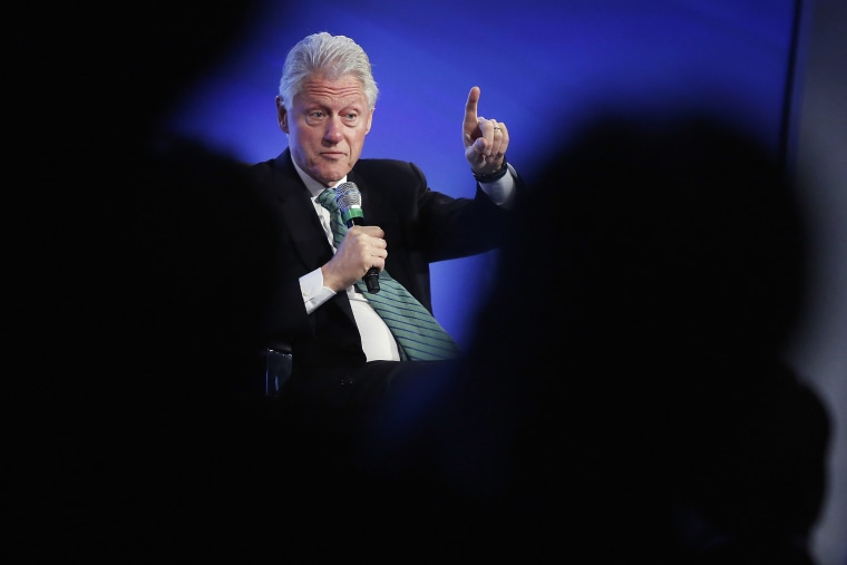 Former U.S. President Bill Clinton gestures during an onstage interview at the 2014 Peterson Foundation Fiscal Summit in Washington May 14, 2014.