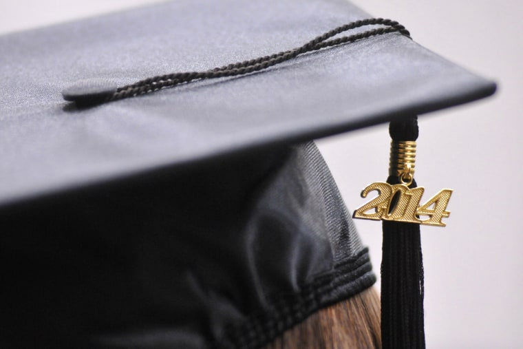 Tassels hang from a cap during commencement exercises on May 9, 2014.