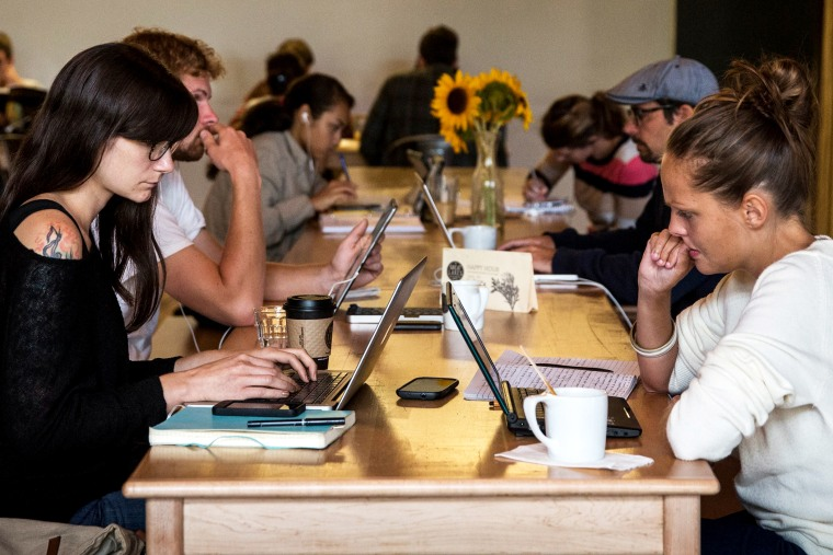 Customers work on their laptops at Great Lakes Coffee Roasting Company on September 6, 2013 in Detroit, Michigan.
