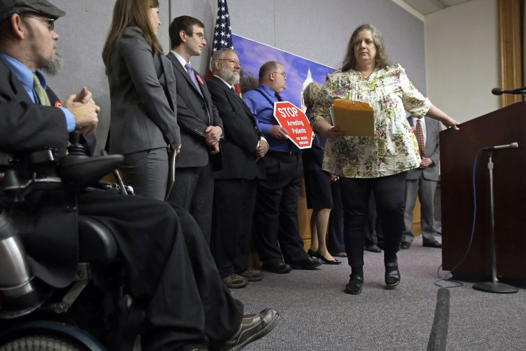 Joni Whiting, right, of Jordan, Minn., leaves the podium after encouraging support of a bill to legalize medical marijuana in Minnesota during a State Capitol news conference on May 2, 2013 in St. Paul, Minn.