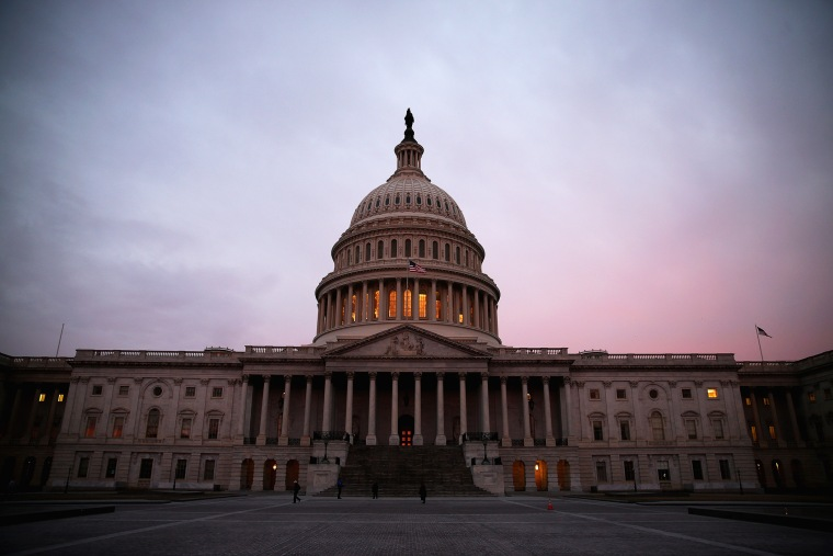 The American Flag flies over the Senate side of the U.S. Capitol, March 11, 2014 in Washington, D.C.