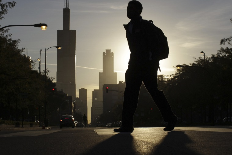 A student makes his way to class at Whitney Young High School in Chicago, on Sept. 19, 2012.