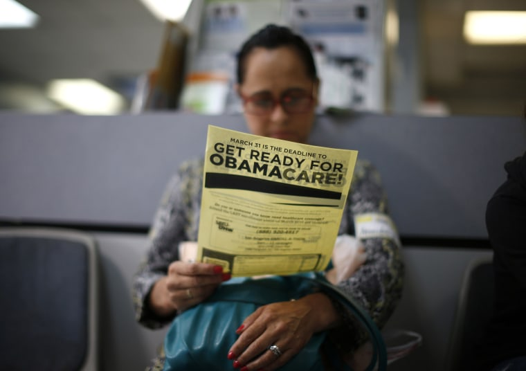 Arminda Murillo, 54, reads a leaflet at a health insurance enrollment event in Cudahy, California March 27, 2014.