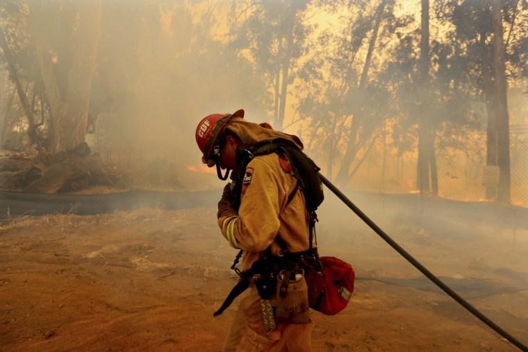 Firefighters battle wildfire in Fallbrook, California