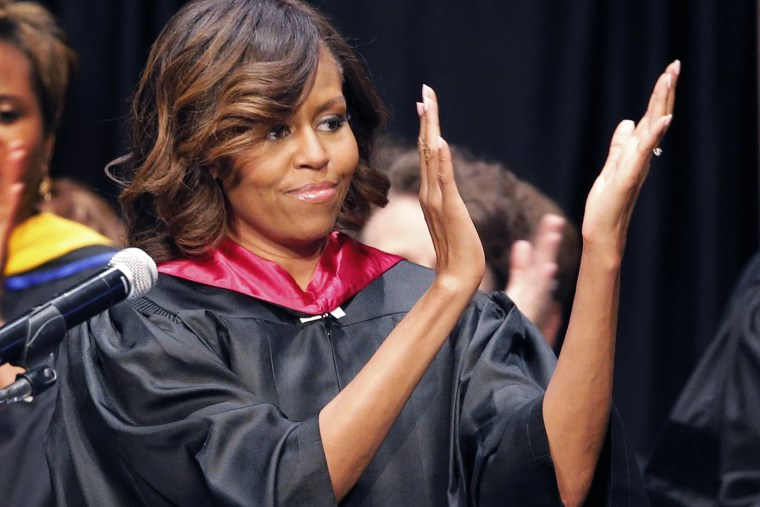 First lady Michelle Obama applauds students during Topeka Public Schools Senior Recognition Program in Topeka, Kan., May 16, 2014.