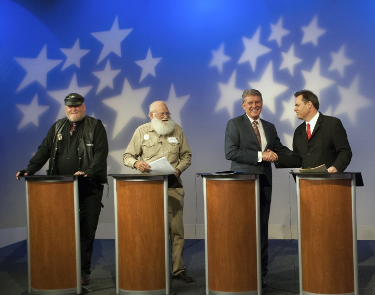 In this image provided by Idaho Public Television, Idaho Gov. Butch Otter, second right, appears on stage with Republican gubernatorial hopefuls, from left, Harley Brown, Walt Bayes, and state Sen. Russ Fulcher, at a debate Thursday May 15, 2014.
