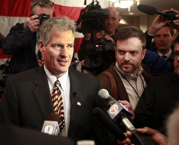 Former Massachusetts U.S. Senator Scott Brown walks into a crowd of supporters after announcing his plans to run for U.S. Senator in New Hampshire, April 10, 2014 in Portsmouth, N.H.
