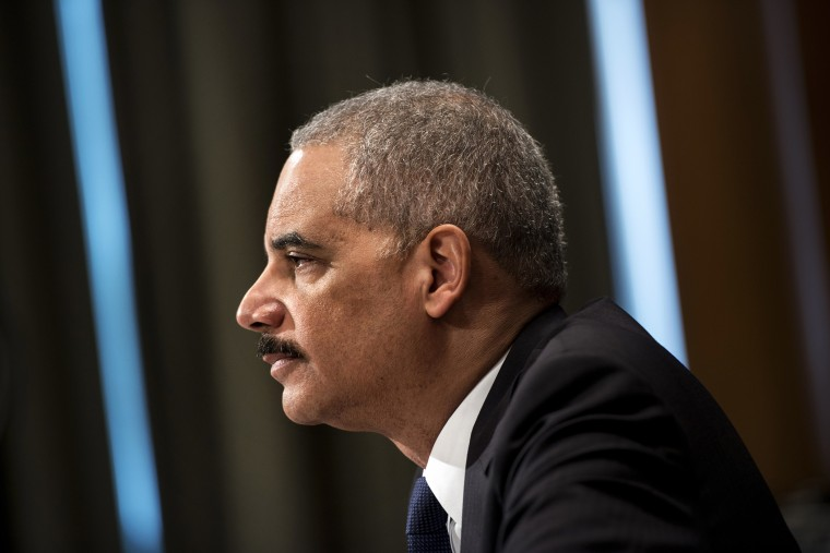 Attorney General Eric H. Holder listens during a hearing on Capitol Hill, April 3, 2014 in Washington, D.C.