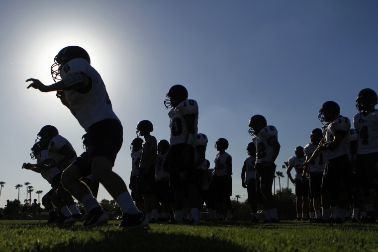 A high school football team practices for their upcoming season in Arizona.