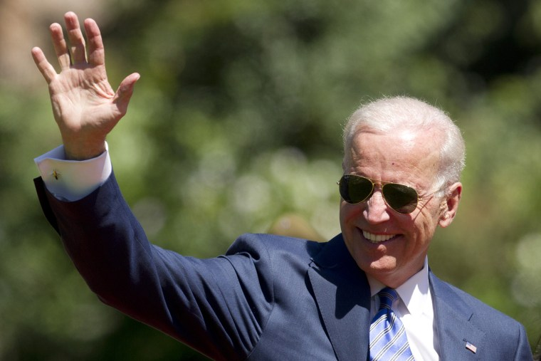 US Vice President Joe Biden waves at the press in Vina Del Mar, Chile on March 11, 2014.