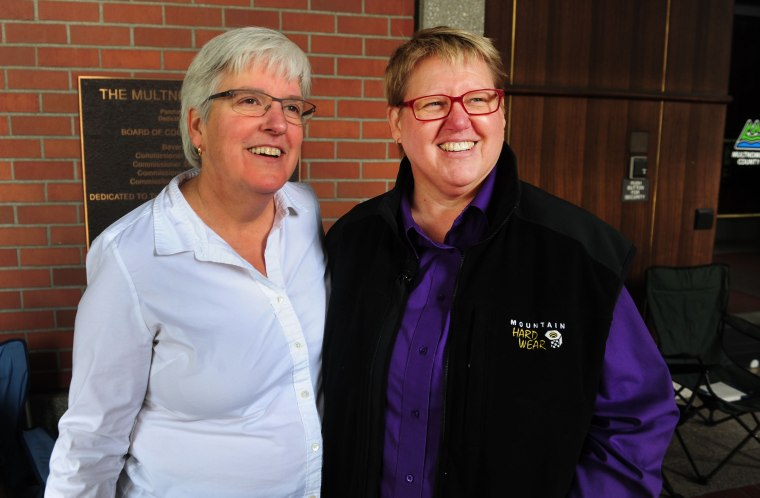 Deana Geiger, left, and Janine Nelson, are interviewed in front of the Multnomah County Recorder's building in Portland, Ore. on May. 19, 2014. Geiger and Nelson are the plaintiffs in the Marriage Equality case.