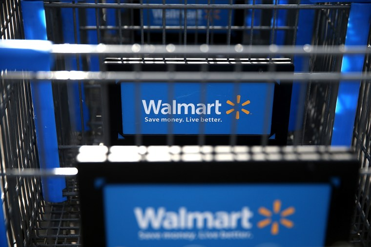 Wal-Mart shopping carts sit outside of a store on Feb. 20, 2014 in San Lorenzo, California.