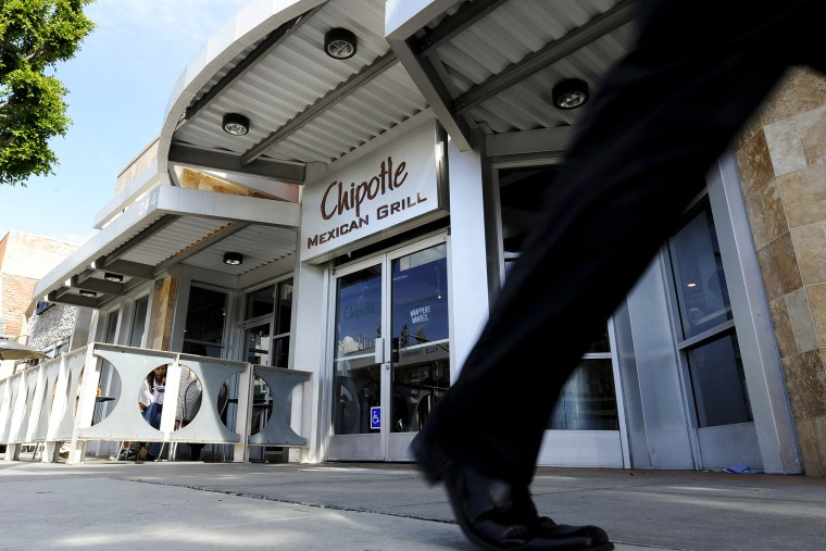 A pedestrian walks past a Chipotle Mexican Grill in Beverly Hills