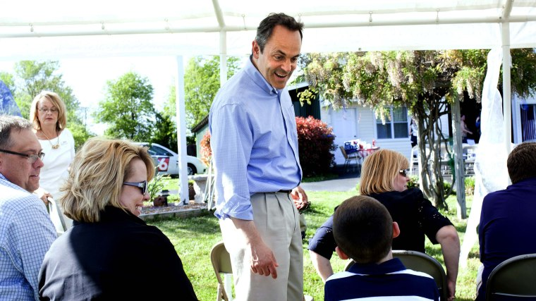 Senate candidate Matt Bevin, center, chats with seven-year-old Cutter Singleton of Marion, Ky., on May 4, 2014, during a supporter picnic in Paducah, Ky.