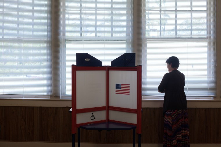 Armelle Minton, chief judge at the Wanchese Community Building in Wanchese, looks out the window waiting for voters on May 6, 2014 during the North Carolina Primary election.