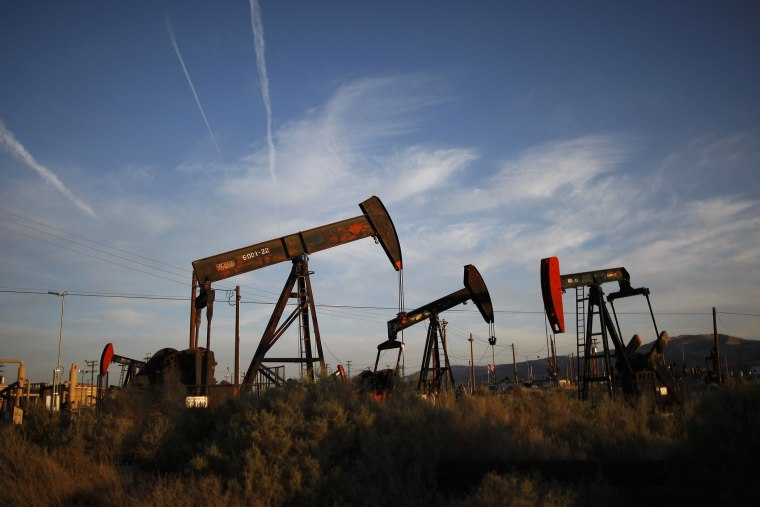 Pump jacks and wells are seen in an oil field where gas and oil extraction uses hydraulic fracturing, or fracking.