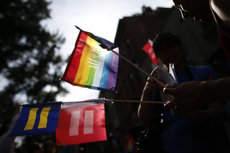 Members of the LGBT community and their supporters gather to celebrate two decisions by the U.S. Supreme Court, one to invalidate parts of the Defense of Marriage Act and another to uphold a lower court ruling that struck down California's controversial P